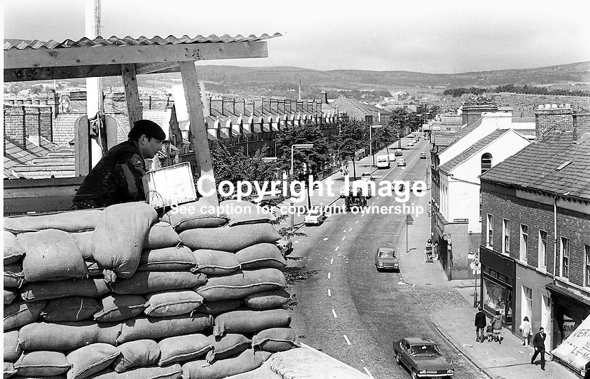 Soldier,2nd Parachute Regiment, in an observation post on the roof of Springfield Road RUC Station, Belfast. Ref: 19710715001...Copyright Image from Victor Patterson, 54 Dorchester Park, Belfast, UK, BT9 6RJ..Tel: +44 28 9066 1296.Mob: +44 7802 353836.Voicemail +44 20 8816 7153.Skype: victorpattersonbelfast.Email: victorpatterson@mac.com.Email: victorpatterson@ireland.com (back-up)..IMPORTANT: If you wish to use this image or any other of my images please go to www.victorpatterson.com and click on the Terms & Conditions. Then contact me by email or phone with the reference number(s) of the image(s) concerned.