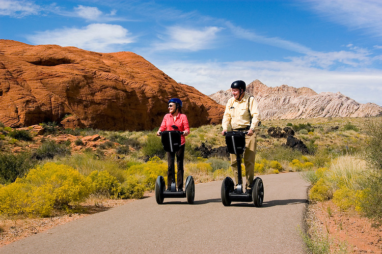 Couple on a Segway at Snow Canyon State Park, Utah, UT, scenic, landscape, Segways, Segway riders, model released, rock formations, landforms, Navajo sandstone, arid, Southwest America, American Southwest, US, United States, Image ut417-18825, Photo copyright: Lee Foster, www.fostertravel.com, lee@fostertravel.com, 510-549-2202