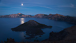 Full moon over Crater Lake reflecting onto the water