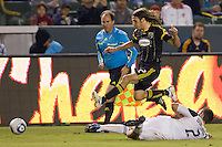 Columbus Crew defender Frankie Hejduk runs over LA Galaxy defender Todd Dunivant chasing the ball. The LA Galaxy defeated the Columbus Crew 3-1 at Home Depot Center stadium in Carson, California on Saturday Sept 11, 2010.