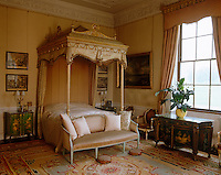 The ornate bed, chairs and Chinese style lacquer furniture in the East Bedroom are by Chippendale and the ceiling plasterwork is by Robert Adam