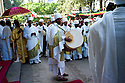 19/01/12. Addis Ababa, Ethiopia. The festival of Timket is celebrated in Addis Ababa, Ethiopia. Numerous parades start at many churches, carrying their replica Arks of the Covenant, accompanied by drumming, singing, harps and ullulation, through the city to Jan Meda. Jan Meda is the place where the baptism of Jesus is commemorated by Orthodox Christian Ethiopians. A drummer heralds the beginning of the Timket procession. Photo credit: Jane Hobson