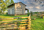 George Roger Clarks log cabin sitson a bluff above the Falls of Ohio around the Ohio River from Louisville, Ky. This Virginia native founded Louisville and eplored the Louisana  Purchase with Lewis. They lauched the exposition from his spot.