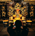 A young boy has his picture taken by a family member while he is dressed as an emperor at a Buddhist temple in Kunming, in the Yunnan province of China. (Photo/Scott Dalton)