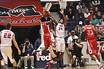 "Ole Miss' Aaron Jones (34) blocks a shot by Rutgers' Eli Carter (5) at the C.M. ""Tad"" Smith Coliseum in Oxford, Miss. on Saturday, December 1, 2012. (AP Photo/Oxford Eagle, Bruce Newman).."