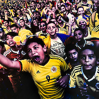 Colombia football fans cheer while watching the match between Colombia and Uruguay at the FIFA World Cup 2014, in a park in Cali, Colombia, 28 June 2014.