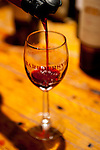 A taste of red wine is poured into my glass at Barboursville Vineyards.