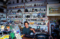 """A man tends shop at the Kaupo Store, a longtime landmark, in Kaupo, Maui. Just past the town of Hana, this shop is one of the only stops on what is referred to as """"the back side."""""""