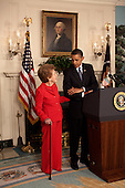 Washington, DC - June 2, 2009 -- Former First Lady Nancy Reagan stands alongside President Barack Obama at the podium as he announces and signs the Ronald Reagan Centennial Commission Act in the Diplomatic Room of the White House, June 2, 2009.&nbsp;<br /> Mandatory Credit: Pete Souza - White House via CNP