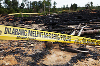 After loosing their land to the palm oil plantation, the villagers of Desa Sungai burned down the company office in protest.