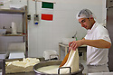 The dough is stretched and kneaded for several minutes until reaches a smooth and shiny consistence.