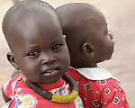 A child in Rumbek, South Sudan wears the traditional necklace of the Dinka ethnic group.