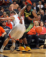 Dec. 17, 2010; Charlottesville, VA, USA; Oregon Ducks forward Joevan Catron (34) gets tangled up with Virginia Cavaliers guard Joe Harris (12) during the first half of the game at the John Paul Jones Arena. Mandatory Credit: Andrew Shurtleff-