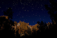 A full moon casts vibrant light onto the hoodoos or Bryce Canyon National Park, Utah.