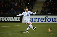 Lorient, France. - Sunday, February 8, 2015:  Abby Wambach (20) of the USWNT takes a penalty kick. France defeated the USWNT 2-0 during an international friendly at the Stade du Moustoir.