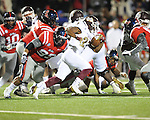 Ole Miss defensive tackle Gilbert Pena (99) tackles Mississippi State running back LaDarius Perkins (27) at Vaught-Hemingway Stadium in Oxford, Miss. on Saturday, November 24, 2012. Ole Miss won 41-24.
