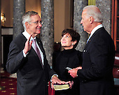 United States Senate Majority Leader Harry Reid (Democrat of Nevada) raises his right hand during the photo-op of the reenactment of his swearing-in in the Old Senate Chamber in the U.S. Capitol in Washington, D.C. on Wednesday, January 5, 2011.  His wife, Landra is at center and U.S. Vice President Joe Biden is at right..Credit: Ron Sachs / CNP.(RESTRICTION: NO New York or New Jersey Newspapers or newspapers within a 75 mile radius of New York City)
