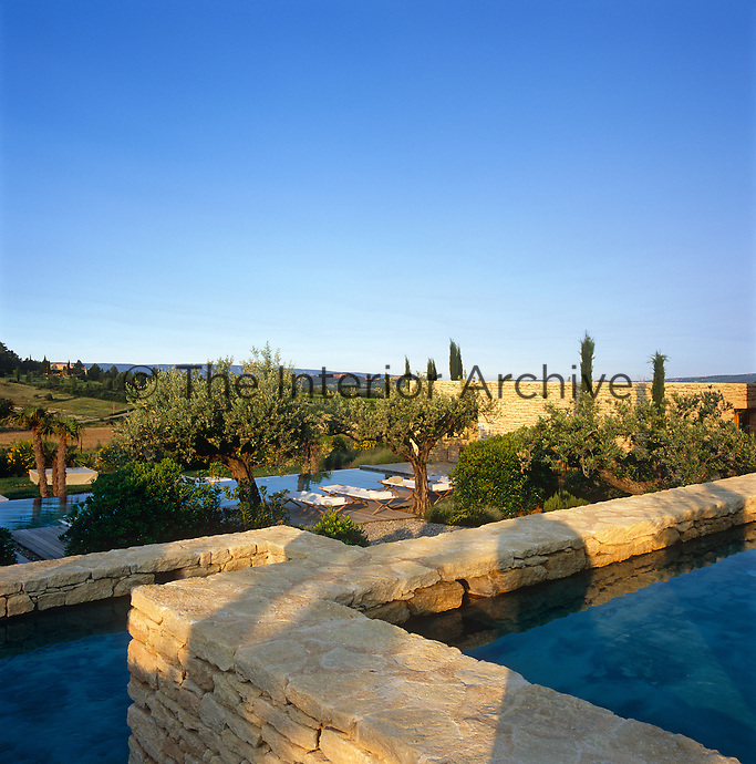 Terraced pools descend from the house to the swimming pool