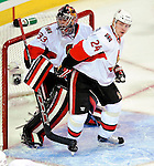 17 October 2009: Ottawa Senators defenseman Anton Volchenkov (24) stands next to his goaltender Pascal Leclaire during game action against the Montreal Canadiens at the Bell Centre in Montreal, Quebec, Canada. The Senators defeated the Canadiens 3-1. Mandatory Credit: Ed Wolfstein Photo