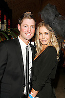 MELBOURNE, AUSTRALIA - OCTOBER 31:  Michael Clarke and Lara Bingle in the Emirates marquee at the AAMI Victoria Derby Day at Flemington Racecourse on October 31, 2009 in Melbourne, Australia.  (Photo by Hannah Mason/WireImage)