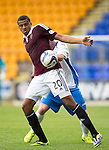 St Johnstone v Hearts...03.08.14  Steven Anderson Testimonial<br /> Osman Sow holds off Tam Scobbie<br /> Picture by Graeme Hart.<br /> Copyright Perthshire Picture Agency<br /> Tel: 01738 623350  Mobile: 07990 594431