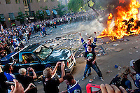 Rioters burn cars on the downtown streets of Vancouver,BC after the Canucks were defeated by the Boston Bruins in the Stanly Cup on June 15, 2011. (photo copyright Karen Ducey)