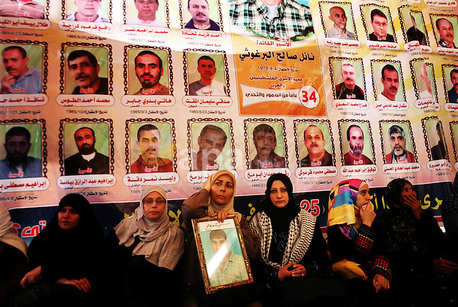Palestinians gather during a protest at the Red Cross' offices in Gaza City to call for the release of Palestinian prisoners held in Israeli jails, on October 17, 2011. Under a prisoner swap deal signed with Israel, the Islamist group Hamas will free captured Israeli soldier Gilad Shalit, held in Gaza since 2006, in exchange for 1,027 Palestinian prisoners. Photo by Ali Jadallah