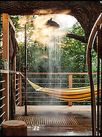 BNPS.co.uk (01202 558833)<br /> Pic: Mallinson/BNPS<br /> <br /> Outdoor shower and hammock...<br /> <br /> Release your inner Tarzan...in Britain's poshest treehouse.<br /> <br /> A luxury glamping site in deepest Dorset has created a luxurious treehouse that comes with its own sauna, hot tub, rotating fireplace and pizza oven.<br /> <br /> The Woodsman's Treehouse is perched 30ft from the ground on long stilts and has two floors. <br /> <br /> It has a spiral staircase and a stainless steel slide for quick access to the ground and can be rented out from &pound;390 a night. <br /> <br /> It is located at the Crafty Camping glamping site at Holditch in west Dorset.