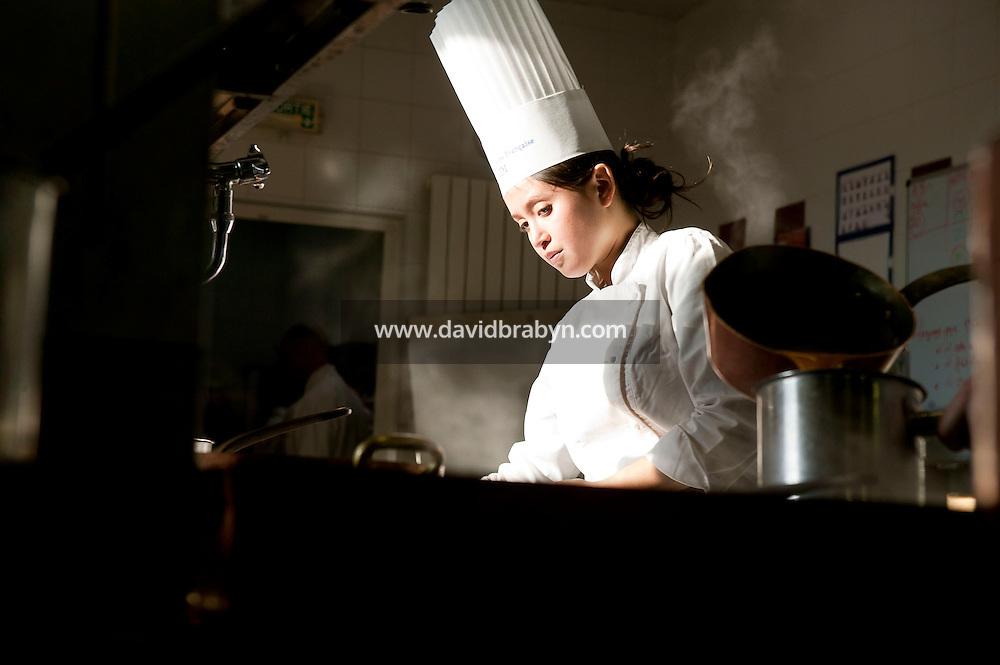 A student cooks during a class at the Ecole Superieure de Cuisine Francaise Gregoire Ferrandi cooking school in Paris, France, 19 December 2007.