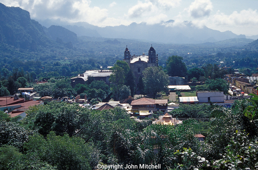 View of the Spanish colonial town of Tepoztlan, Morelos, Mexico. Tepoztlan is built on the ruins of an ancient Aztec city said to be the birthplace of the god Quetzalcoatl. Tepoztlan has been designated a pueblo magico or magical town. The 16th-century Ex-Convento Dominico de la Natavidad that dominates Tepoztlan's skyline is a UNESCO World Heritage Site.