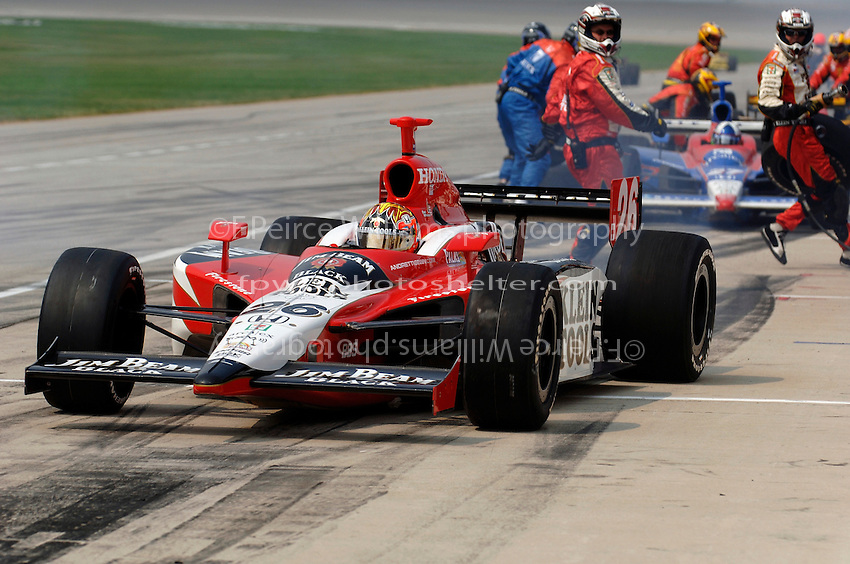 11 September, 2005, Joliet,IL,USA<br /> Dan Wheldon exits his pit following his first pitstop.<br /> Copyright&copy;F.Peirce Williams 2005