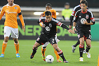 D.C. United midfielder Danny Cruz (2) shields the ball from Houston Dynamo defender Corey Ashe (26)  D.C. United defeated The Houston Dynamo 3-2 at RFK Stadium, Saturday April 28, 2012.