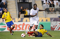 Mario Yepes (3) of Colombia (COL) tackles the ball away from Eddie Johnson (9) of the United States (USA). The men's national teams of the United States (USA) and Colombia (COL) played to a 0-0 tie during an international friendly at PPL Park in Chester, PA, on October 12, 2010.