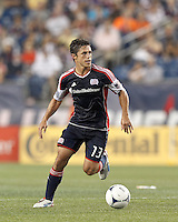 New England Revolution midfielder Ryan Guy (13) looks to pass. In a Major League Soccer (MLS) match, Montreal Impact defeated the New England Revolution, 1-0, at Gillette Stadium on August 12, 2012.