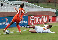 COLLEGE PARK, MD - OCTOBER 28, 2012:  Sarah Fichtner (25) of the University of Maryland slides into Jasmine Paterson (15) of Miami during an ACC  women's tournament 1st. round match at Ludwig Field in College Park, MD. on October 28. Maryland won 2-1 on a golden goal in extra time.