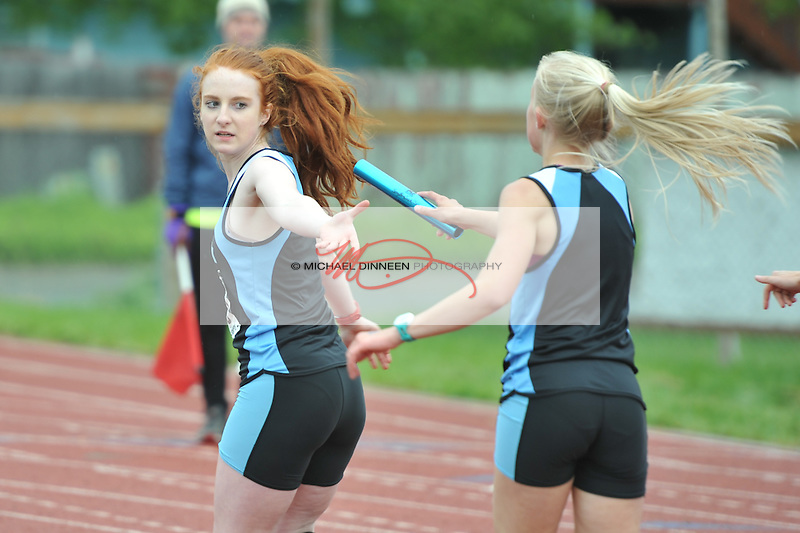 Chugiak's Reilly Hall takes the baton from teammate Emma Sees for her championship-winning anchor leg of the 4x400 relay at the Region IV Track and Field Championships.  Photo by Michael Dinneen for the Star