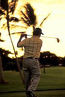 Golfer at sunset at Ko Olina, Oahu.