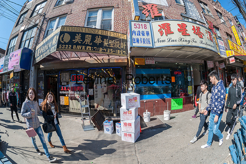 Businesses on Eighth Avenue in the Sunset Park neighborhood in Brooklyn in New York on Sunday, February 28, 2016 during the Lantern Festival street fair. Sunset Park has become Brooklyn's Chinatown as Chinese and other Asian groups have moved there and businesses have sprouted up to cater to them. (© Richard B. Levine)
