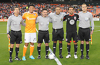 D.C. United forward Dwayne De Rosario (7) with Houston Dynamo forward Brian Ching (25) and MLS referees at the coin toss.  D.C. United defeated The Houston Dynamo 3-2 at RFK Stadium, Saturday April 28, 2012.