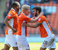 Blackpool's Mark Cullen celebrates scoring the opening goal with teammates Jack Payne and Neil Danns<br /> <br /> Photographer Alex Dodd/CameraSport<br /> <br /> The EFL Sky Bet League Two - Blackpool v Cheltenham Town - Saturday 22nd April 2017 - Bloomfield Road - Blackpool<br /> <br /> World Copyright &copy; 2017 CameraSport. All rights reserved. 43 Linden Ave. Countesthorpe. Leicester. England. LE8 5PG - Tel: +44 (0) 116 277 4147 - admin@camerasport.com - www.camerasport.com