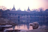 Bathing in Bagmati River & praying at temple.