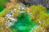 Blue-green waterfalls. Plitvice Lakes National Park, Croatia Water-colored from limestone and travertine