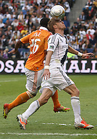 CARSON, CA - DECEMBER 01, 2012:   Christian Wilhelmsson (9) of the Los Angeles Galaxy nods the ball past Corey Ashe (26) of the Houston Dynamo during the 2012 MLS Cup at the Home Depot Center, in Carson, California on December 01, 2012. The Galaxy won 3-1.