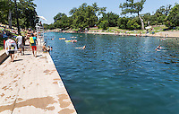 """Each summer thousands of locals and tourist swim in the constant 68-degree waters of Barton Springs Pool, a spring-fed swimming hole in Zilker Park. Daily, 5am-10pm. Voted the """"Best Swimming Hole in Texas."""" Closed Thursdays, 9am- 7pm."""