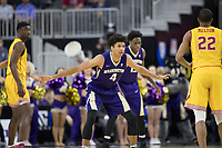 LAS VEGAS, NV - March 8, 2017: Washington Huskies vs. the USC Trojans in the opening round of the Pac-12 Men's Basketball Tournament.  Final Score: Washington Huskies 73, USC Trojans 78