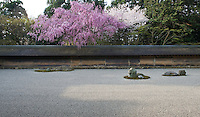 """The Ryoan-Ji garden was built in 1450 by Hosukawa Katsumoto in the """"dry landscape"""" style and features sand, rocks and moss"""