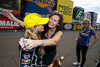 Mar 20, 2016; Gainesville, FL, USA; NHRA top fuel driver Brittany Force (left) is congratulated by mother Laurie Force (center) and sister Courtney Force as she celebrates after winning the Gatornationals at Auto Plus Raceway at Gainesville. Mandatory Credit: Mark J. Rebilas-USA TODAY Sports
