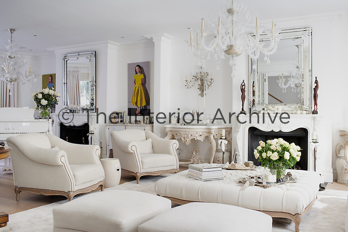 The living room has been designed in a colour scheme of white-on-white creating an elegant and tranquil mood