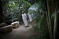 """MAE CHEE KON KHAI leads a walking meditation to a retreat female group as part of the Sathira Dhammasathan spiritual teaching program for the lay people. Vanished by centuries the lineage of """"Bhikkhu?nii"""" (Order of Nuns) has been brought to the ongoing Thai society's debate. White-clad thai nuns, who keep the eight precepts and have their heads and eyebrows shaved are known as the lon-existing """"mae chees"""" (low category to call the lay nuns). Females who have turned to religous life, as renunciants, live ostracized and marginalized by the Sangha (Buddhist community) and Thai society, denying them full access to the monastic life as well as rights and support from the government. Today nunhood is not recognized by any asian country belong to the Theravada Buddhist order. Most of the eight precept holders live in temples run by male abbots, at the shadow of the monks; with the exceptional existence of a few para-monastic institutions as the Sathira Dhammasathan meditation centre, where """"mae chees"""" are not allow to held a temple, but not denied to practice the spiritual life."""