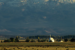 Little Shasta church, 1878) at sunset with Mount Shasta looming in the background, Northern California USA.